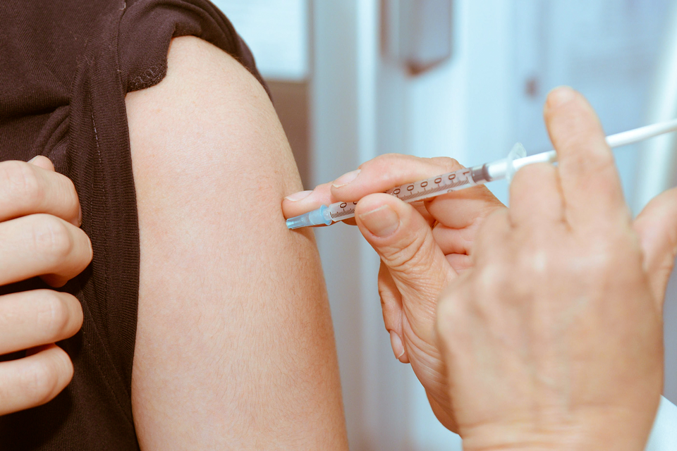 A healthcare worker vaccinating a patient