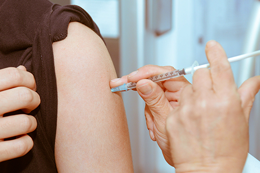 healthcare worker vaccinating a patient